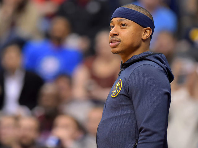 WASHINGTON DC - MARCH 21 Isaiah Thomas 0 of the Denver Nuggets looks on from the bench during the first half against the Washington Wizards at Capital One Arena on March 21 2019 in Washington DC