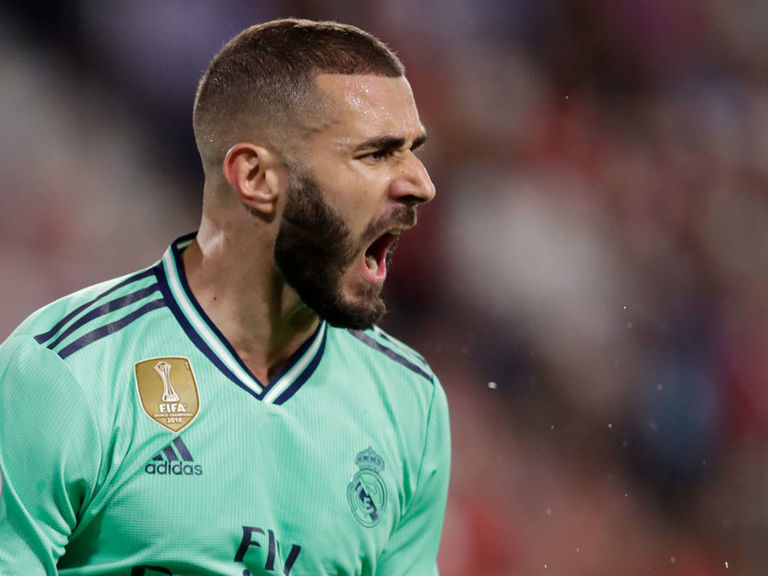 Red-hot Benzema leads Real Madrid past Sevilla