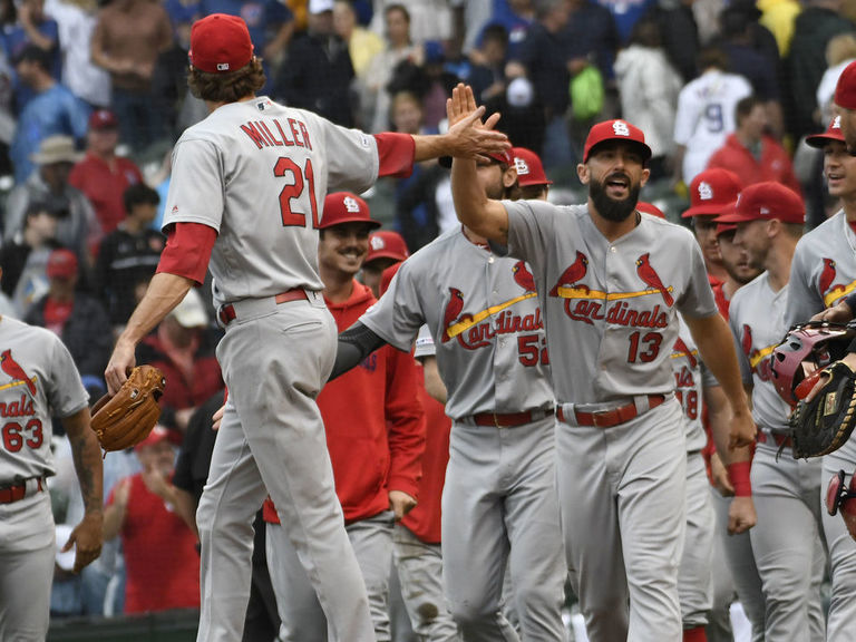 Cardinals rally to sweep Cubs and secure playoff berth
