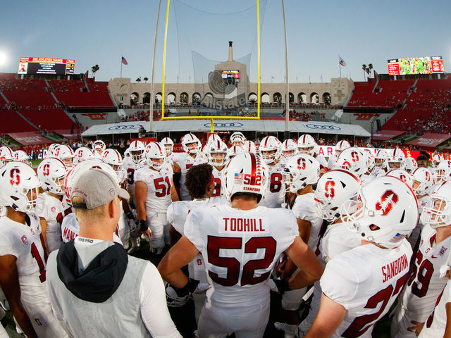 LOS ANGELES CA - SEPTEMBER 07 The Stanford Cardinal football team huddles before the game during a game between USC and Stanford Football at Los Angeles Memorial Coliseum on September 7 2019 in Los Angeles California