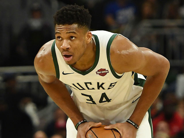 MILWAUKEE WISCONSIN - NOVEMBER 21 Giannis Antetokounmpo 34 of the Milwaukee Bucks handles the ball during a game against the Portland Trail Blazers at Fiserv Forum on November 21 2019 in Milwaukee Wisconsin