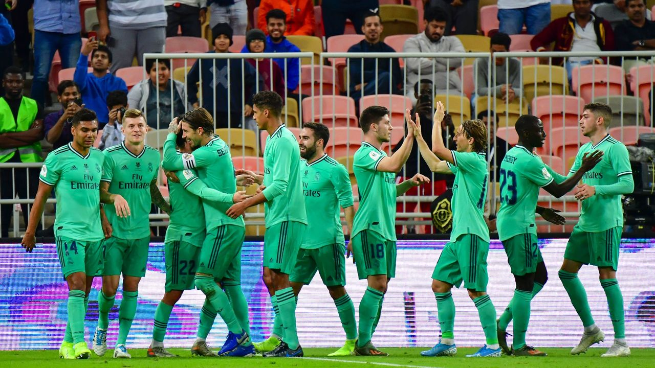 Real Madrid's players celebrate their goal during the Spanish Super Cup semi final between Valencia and Real Madrid on January 8, 2020, at the King Abdullah Sport City in the Saudi Arabian port city of Jeddah.